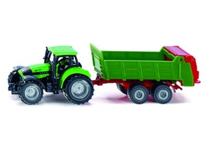 Tracteur avec épandeur universel