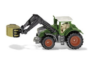 Tracteur avec chargeur et pince à balles